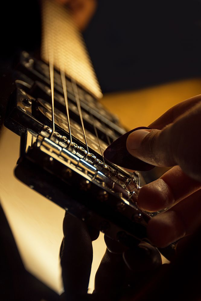 Electric guitar being played by one hand.jpg
