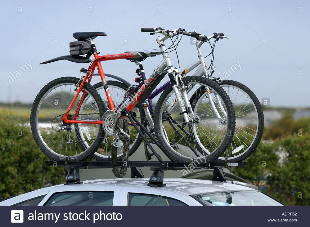 bikes-on-top-of-a-car-roof-rack-in-preparation-for-a-cycling-holiday-ADPF62.jpg