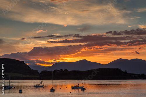 The harbor at Oban, Scotland at sunset.